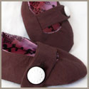 Brown baby booties with snap closure